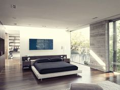 I love an open room where the bed is not pushed up against a side wall or crammed into a corner. Feels light and simple. LB