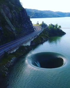 The Glory Hole from Located in Lake Berryessa, this hole was manufactured to work as a drain for the Monticello Dam. Carrying 526 BILLION GALLONS of water, it is a safe way of transporting water to the surrounding area. Beautiful Places To Travel, Wonderful Places, Amazing Places On Earth, Places Around The World, Amazing Things, Nature Pictures, Amazing Nature, Beautiful Landscapes, Beautiful Nature Photography