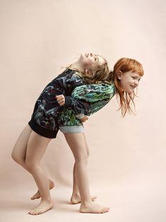 Wildkids for La Petite Magazine, photography by Marijke de Gruyter styling & creative direction by Jet Vervest, hair and make-up by Ingrid Boekel @Houseoforange,  Anna: Munster sweater & Loula: Molo Sweater