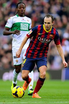 Andres Iniesta of FC Barcelona duels for the ball with Carlos Sanchez of Elche FC during the La Liga match between FC Barcelona and Elche FC at Camp Nou on January 5, 2014 in Barcelona, Catalonia.