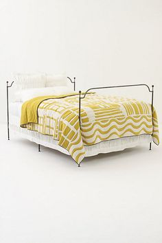 yellow quilt and pin tuck bedding