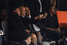 David Cameron (Prime Minister of United Kingdom), Helle Thorning-Schm (Prime Minister of Denmark), and Barack Obama (President of the United.States ) taking selfies at Memorial Service..