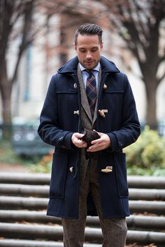 A complete history and definition of the men's duffle coat. Includes an outfit idea for a duffle coat with tweed suit and plaid tie for winter business. Mens Fashion Winter Coats, Mens Winter Coat, Winter Outfits Men, Winter Suit, Gentleman Mode, Gentleman Style, Mens Fashion Blog, Best Mens Fashion, Herren Winter