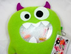"""Green monster """"I Spy"""" bag.  $27.00 from 1PixiePlace."""