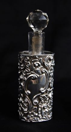 Victorian perfume bottle in silver holder