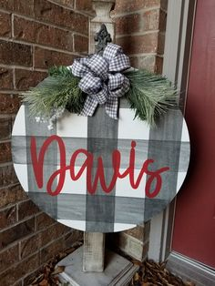 This personalized bufflo plaid door hanger is a classic option to adorn your door this winter.. Sign measures approximately 21 and is painted with a distressed buffalo plaid, personalized with your last name. Please enter name in the personalization sectioi at checkout. All of Junque