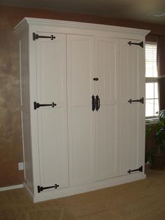 Murphy bed, great idea for bonus room and extra sleeping space! MASTERPIECE DESIGN - Home