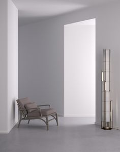 AKAR DE NISSIM IN NEW YORK Project - The RASCACIELO floor lamp inspired from a new skyscraper under construction in Brooklyn pairing with the CIGAR lounge chair.