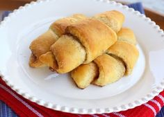 Cinnamon Crescent Rolls   adapted slightly from For The Love Of Cooking    1 package of refrigerated crescent roll dough  1/4 cup butter, softened  1/2 tablespoon cinnamon  1/4 cup sugar    Preheat the oven to 375 degrees. Combine the cinnamon and sugar together and mix well. Place the unrolled crescent rolls onto an ungreased cookie sheet. Spread a layer of butter on each triangle; top with cinnamon and sugar mixture. Roll from the bottom of the triangle to the point.    Place in the oven…