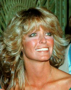 Farrah smiles from a beautiful tanned face.