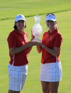 Paula Creamer and Juli Inkster of the USA with the trophy after the Sunday singles matches at the 2009 Solheim Cup Matches, at the Rich Harvest Farms Golf Club on August 23, 2009 in Sugar Grove, Ilinois #SC13