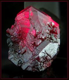 A very large and perfect Cuprite crystal from the Red Dome Mine in Chillagoe, 30x22mm, if anybody is familiar with cuprite, crystals of this size & upwards are incredibly rare. They appear jet black however appear blood red when they are of gem quality and are backlit. The mine has long since stopped producing specimens of this quality, and only a few of this quality ever made it into collections.