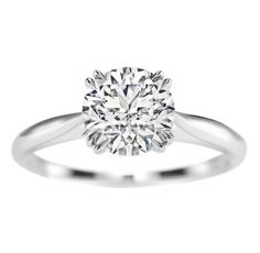 Harry Winston Round Brilliant Solitaire  Round brilliant diamond engagement ring, featured here in 3.01 carats; platinum setting.