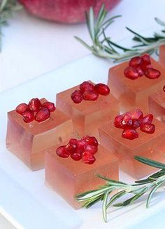 Pomegranate and Rosemary Holiday Jelly Shots! Festive and classy jelly shots that are sure to get you a kiss under the mistletoe!