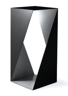Interesting for the house. A Triangulation Side Table...good conversation piece.