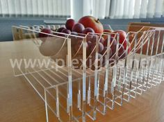 http://www.plexiglas.net/product/plexiglas/en/references/home-garden/Pages/fruit-basket.aspx We eat with our eyes. Who wouldn't want to reach for the content of this imaginative fruit basket? This basket is made from PLEXIGLAS® and looks different from every angle. It is playful yet simple, elegant and functional.