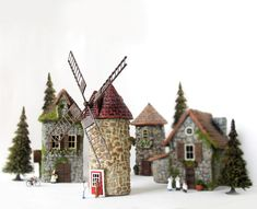 https://flic.kr/p/d91BW3 | Ile Auc Coudres Windmill - Quebec Canada - HO Scale Miniature | My latest Hermitage Collection piece is this windmill inspire by the historic windmill in Quebec province on the Isle aux Coudres. The other buildings pictured are from my Medieval Stone Village set. I plan to make the accompanying watermill as well. :) About the windmill: The Isle-aux-Coudres is located in the St. Lawrence River three kilometers from it's north shore. In 1815, famine struck becau...