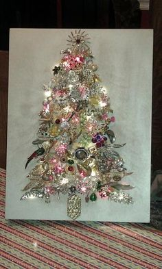 Vintage Jewelry Crafts I finally made my jewelry tree out of a lot of my mother in law's and mother's old costume jewelry. by shawna Jeweled Christmas Trees, Christmas Tree Art, Christmas Jewelry, Vintage Christmas, Christmas Decorations, Holiday Decor, Handmade Christmas, Christmas Ideas, Christmas Inspiration