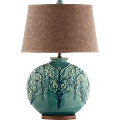 Add a pop of style to your reading nook or bedside with this delightful ceramic table lamp, showcasing a turquoise-hued base and raised vine motif.   ...