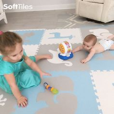 SoftTiles Safari Animals Play Mat Set with borders in Light Blue, Light Gray, and White. Our new lighter colors look great in baby nurseries and playrooms!