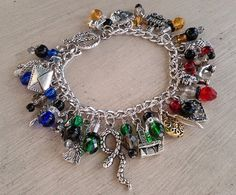 Hogwarts Charm Bracelet - JEWELRY AND TRINKETS - I'm on a Harry Potter crafting kick again. This is a Hogwarts themed charm bracelet I made as a custom order for a friend. The charms Harry Potter Schmuck, Harry Potter Jewelry, Harry Potter Decor, Harry Potter Outfits, Harry Potter Bracelet, Harry Potter Accesorios, Ancient Runes, Welcome To Hogwarts, Harry Potter Images