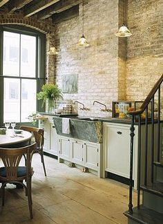Exposed brick kitchen wall and a fabulous old soapstone sink.