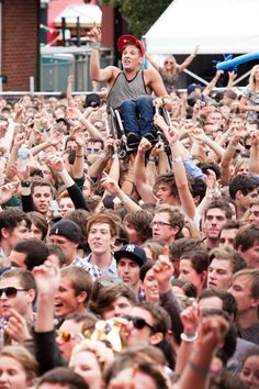 25.) This crowd helped a young man in a wheelchair crowd surf.