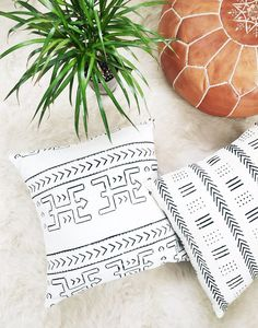 Boho Chic Kita African Mudcloth Pillow Bold and graphic. Using traditional mudcloth techniques, African artisans handcraft this bold dashed throw pillow. Each pillow features hand-drawn designs from local traditions. Looks great on your sofa or favorite chair! MUD CLOTH: An ancient African tradition, mud cloth or bogolanfini, is a handmade cotton fabric dyed using a process of fermented mud dating back to the 12th century. Each textile is hand painted, dried, and rinsed in a process that tak