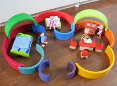 Make your own rainbow dollhouse with Grimm's extra large 12-piece Rainbow multi-purpose stacking toy from Europe! Creativity knows no bounds! #GrimmsToys
