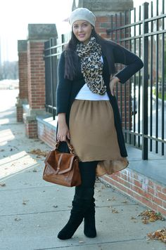 Tanesha of Girl With Curves looks classically chic in a cream beret.
