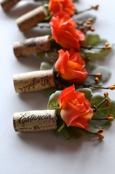 Boutineers for the groomsmen incorporating corks. Super adorable for a vineyard wedding!