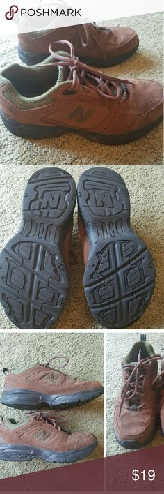 New Balance suede hiking shoes Men's size 9 D, regular. Brown suede. Gently used. No damage or signs of wear. See pic for tread life, plenty of tread left. I would rate the condition an 8 out of 10. New Balance Shoes Athletic Shoes