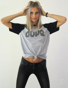 A grey fitted unisex tee with black raglan sleeves gives this shirt a distinguished look. Designed with a hyperactive font that can be seen from miles away. Sit back, and stand out. #staydope Female m