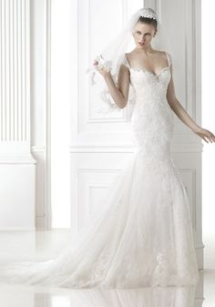 Pronovias 2015 Collection - Tip-of-the-shoulder wedding dress.  Available at Designer Bridal Room