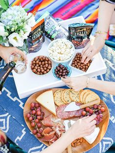 Movie night essentials: champagne, popcorn, a cheese plate, and premium chocolate from Lindt HELLO Bites {yum}
