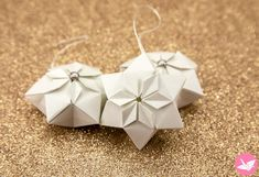 Learn how to fold a beautiful hexagonal origami puffy star! These origami stars can be hung as decorations or displayed as they are. The neat thing about these stars is that the pop out from being a flat tato/coaster!