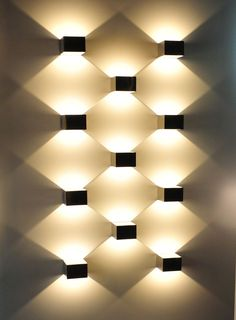 Use directional light to create geometrical wall art piece. #lightingdesign