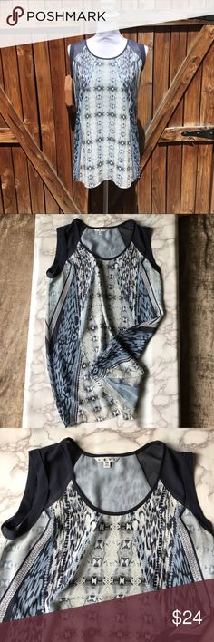 CAbi blue animal print poly flowy top XS navy Really pretty powder blue/navy blue combo printed CAbi top. Lots of great detail on this double lined  top. Size extra small great flow and movement. High quality construction with lots of great trim in navy CAbi Tops Blouses