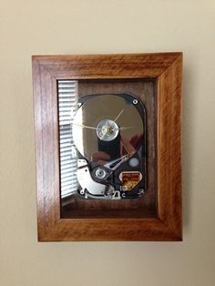 Crafted clock made from a computer's hard drive! Encased in a shadow box. Customized to order!