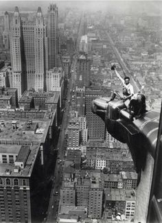 Two men clean a corner of the ornamentation eagle of the Chrysler Building, New York, 1932