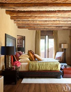 Will and Jada Pinkett Smith at Home in Malibu : Architectural Digest  Ancient salt cedar latillas decorate the ceiling of a guest bedroom.