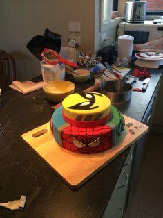 Superhero birthday cake. Bottom has quarters with Spider-Man, Hulk, Captain America and Iron man. Top is wolverine. Chocolate and vanilla cakes!