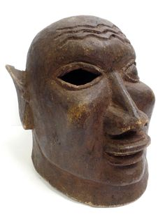 Lot #50 A Makonde Helmet Mask ESTIMATED SELLING PRICE R4000 - R6000 Tanzania / Mozambique Mid 20th Century. Carved forehead features, pierced eye, protruding facial features, elaborate ears. 250mm (height)