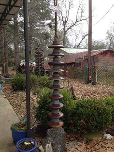 Rain chain. I made of discarded power line insulators