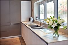 A bulthaup b3 roller shutter provides a convenient space to hide away those everyday items that can often clutter the worktops.