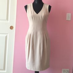 VINCE CAMUTO TAN DRESS Beautiful VINCE CAMUTO drees with pockets. Perfect conditions like brand new. Worn only once. Vince Camuto Dresses Midi