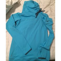 NWOT Nike dri fit long sleeve top NEW nike top great for outdoor sports or just to wear causally. Never worn without tags. Pretty turquoise color blue. Silky dri fit fabric very comfortable. Tie at neck allows u to adjust how much coverage you want. Nike Tops Tees - Long Sleeve