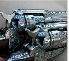 Engraving, sweet. My blued custom grip 38 colt, 2 1/2 inch ribbed barrel w an orange site was engraved by a master jewerler from southern Indiana. My baby love.