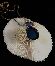Handmade brass working box necklace with sterling silver lapis lazuli cabochon and blue enamel. I hand saw every tiny opening then file and polish them to perfection. Unique jeweler pieces @ benches on division.