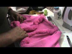 Four part video on machine knitting a bolero.